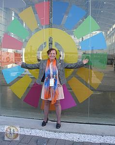 bircan-unver-in-front-of-the-duggal-greenhouse-sdgs-symbol-oseforallforum