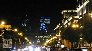 baku-flame-towers-in-night-with-solder-nd-flag-bu-0781